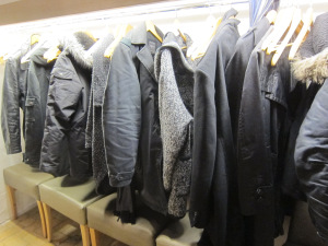 A self-serve cloak room. The color black is definitely in.